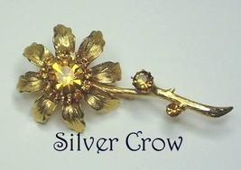 Gold Tone Daisy Pin with Topaz Rhinestones - $13.99