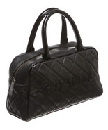 Chanel Black Caviar Travel Bag - $1,595.00