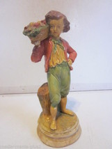 VINTAGE CHALKWARE YOUNG BOY HOLDING BASKET OF FRUIT ON SHOULDER FIGURINE - $9.99