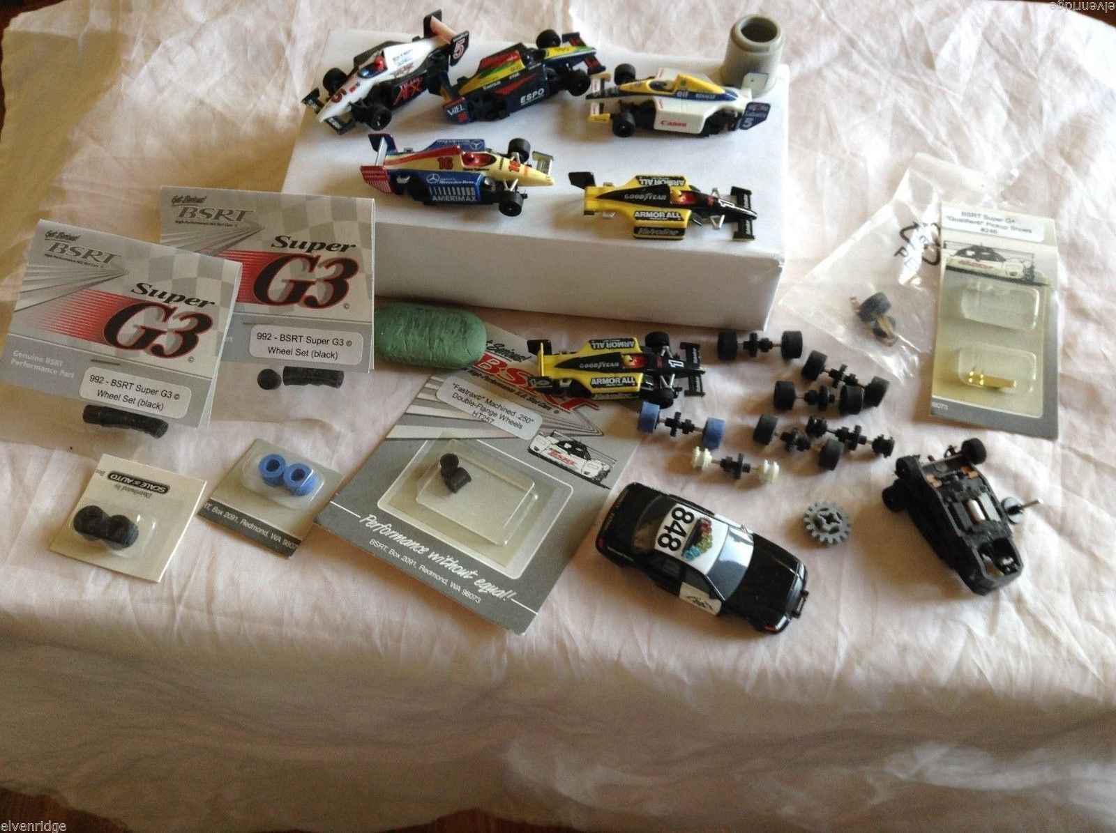 "Lot of different car models and car parts, sizes range from 2""-2-3/4"""