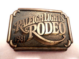 VINTAGE BRASS PLATED METAL BELT BUCKLE RALEIGH LIGHTS RODEO 1981 JJ BUCK... - $12.19