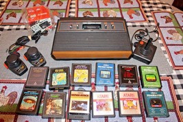 ATARI 2600 VIDEO COMPUTER SYSTEM CONSOLE BUNDLE 12 GAME ALL TESTED WORKS... - $98.01