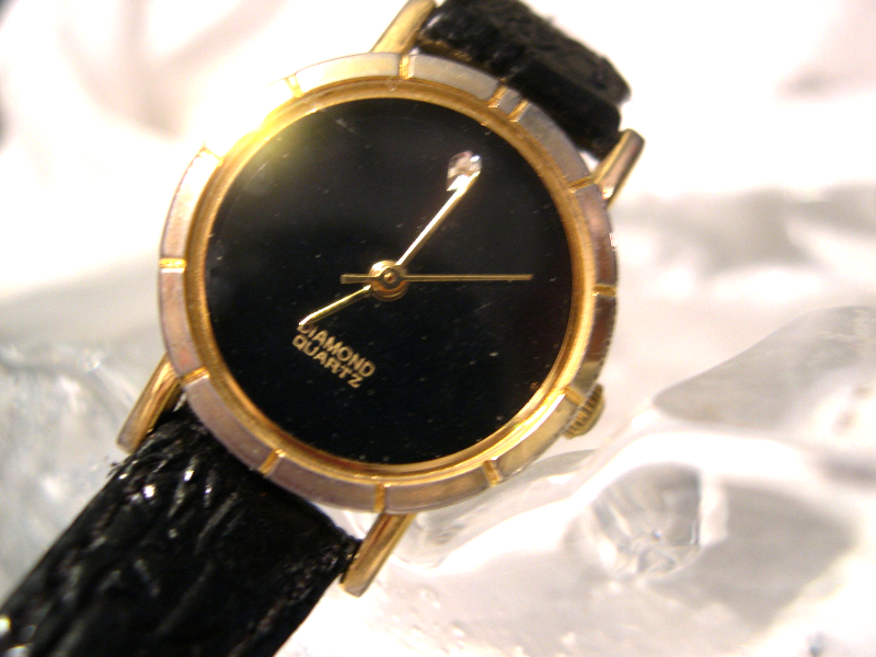 "Primary image for L56, Generation, Ladies Black Face Watch, Gold Tone, 7.5"" Blk. Leather Band w/b"