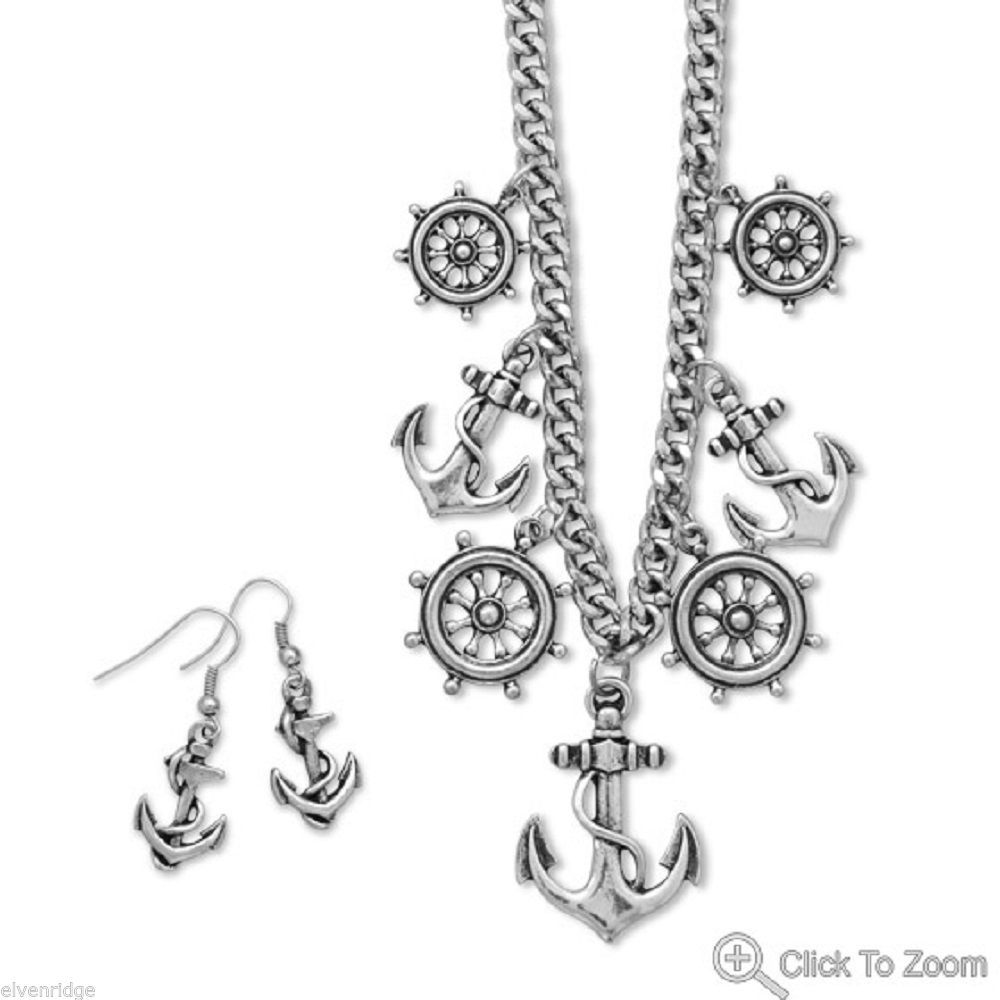 Silver tone fashion anchor and ship's wheel cruise wear necklace earring set