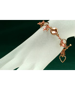 Shimmering bracelet with Swarovski crystal charms, rose gold plated - $65.00