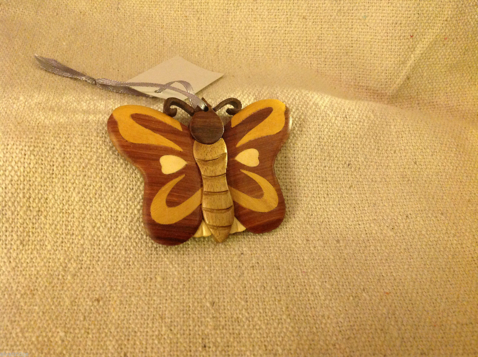 Hand carved multi colored grained wood butterfly ornament double sided