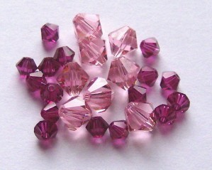 Primary image for 28 Swarovski 4/6mm Bicone 5328 Crystal Beads FUCHSIA/LIGHT ROSE