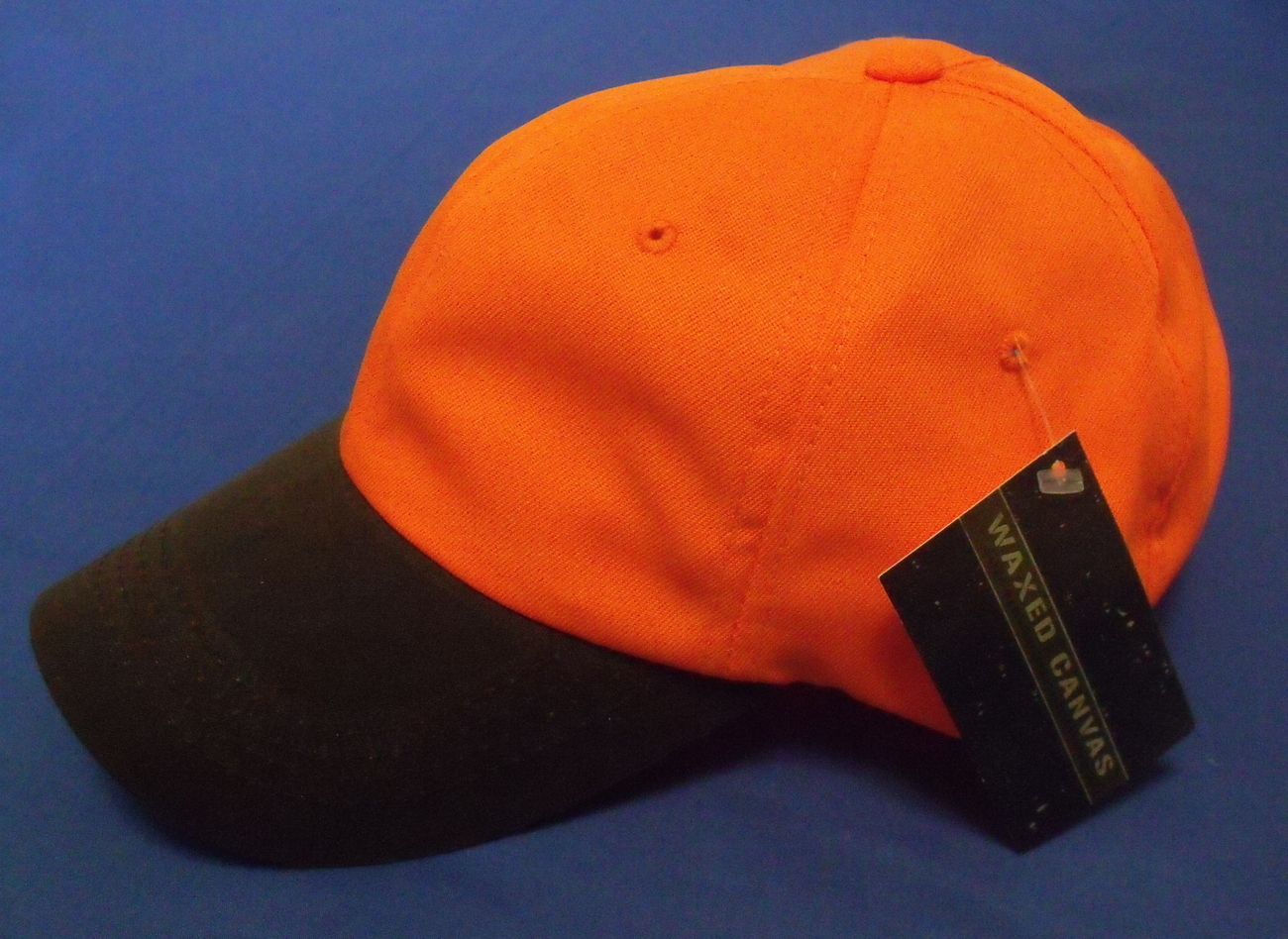 Outdoor cap orange waxed canvas left ball cap