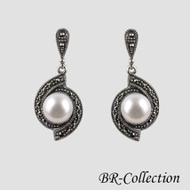 Sterling Silver Earrings with Natural White Freshwater Pearl and Swiss M... - $51.43