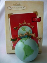 "HALLMARK 2003 ""MERRY CHRISTMAS WORLD"" LIGHT & SOUND ORNAMENT - NEW IN BOX - $14.99"