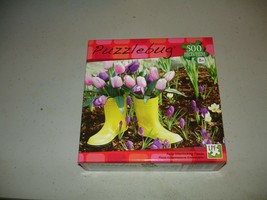 Puzzlebug 500 Piece Puzzle - Yellow Boots in the Garden - Brand New, Sealed - $7.91