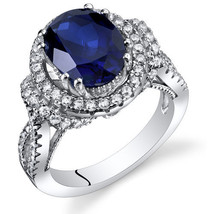 Women's Vintage Sterling Silver Oval Blue Sapphire Halo Ring - $212.37 CAD