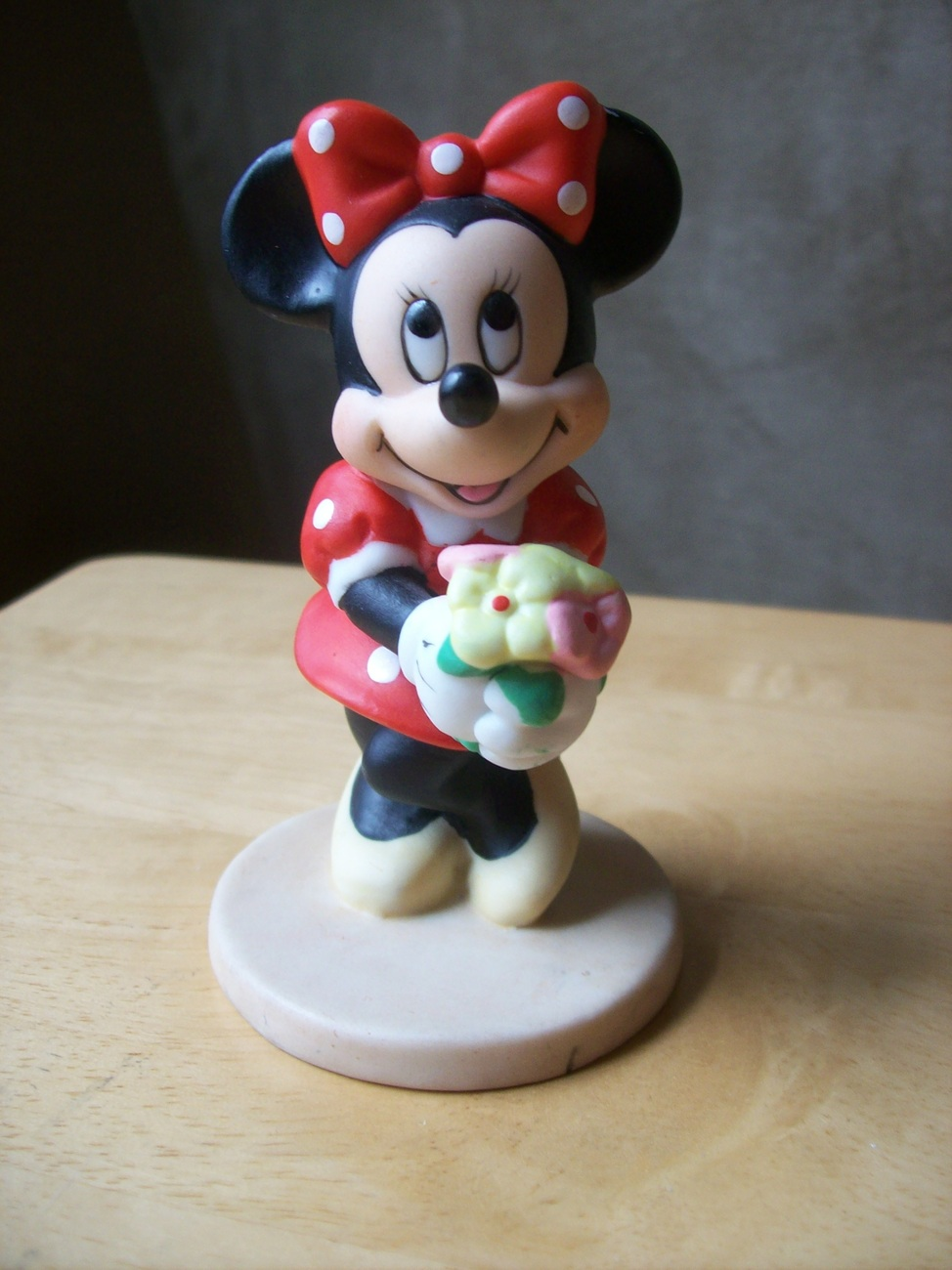 Primary image for Disney Minnie Mouse Holding Flowers Porcelain Figurine