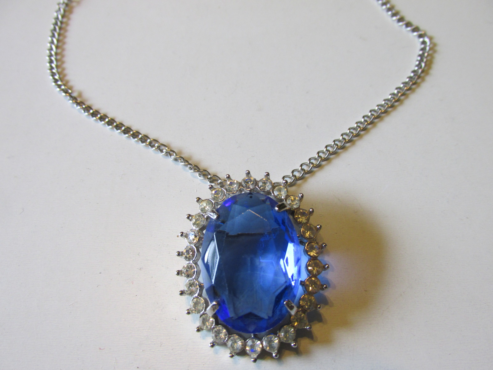 "Primary image for Vintage Avon ""Creation In Blue"" Faceted Glass Pendant Necklace / Brooch - 1972"