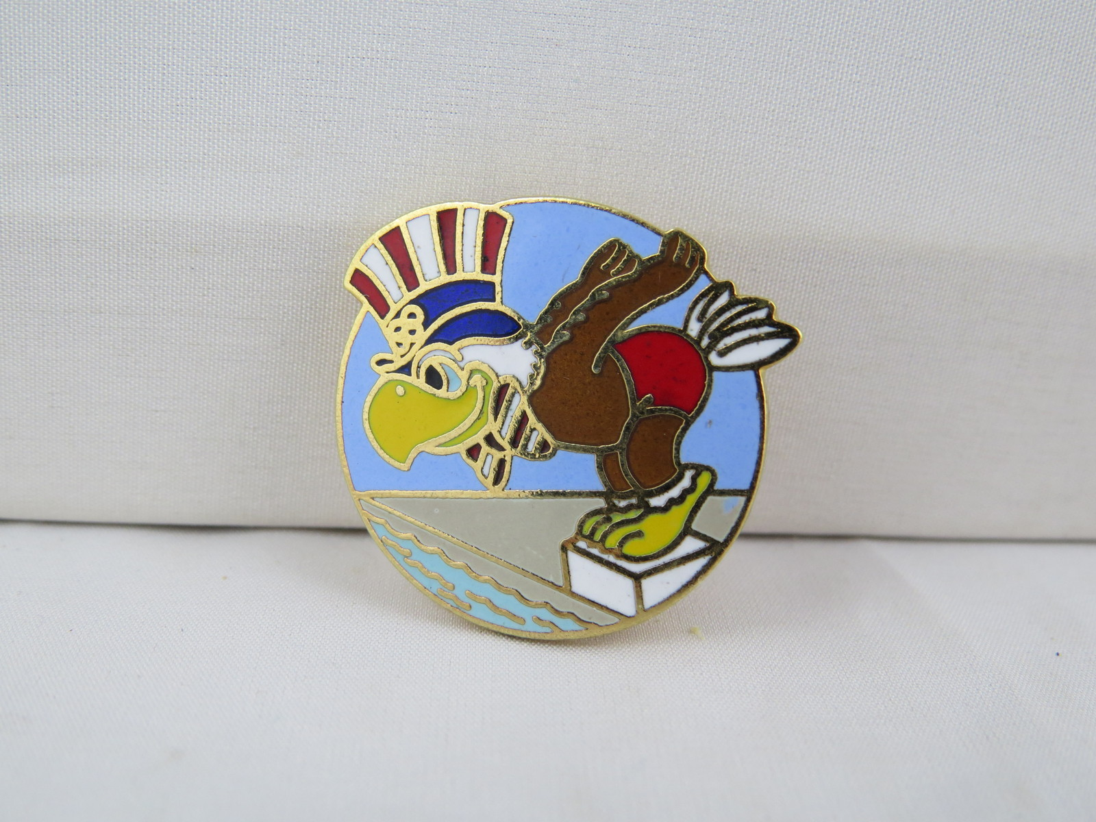 1984 Summer Olympic Games Pin - Swimming Event - Featuring Sam the Mascot
