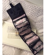 Cosmetic Lot...Rollup carrier, Lipsticks, and Display racks  - $19.00