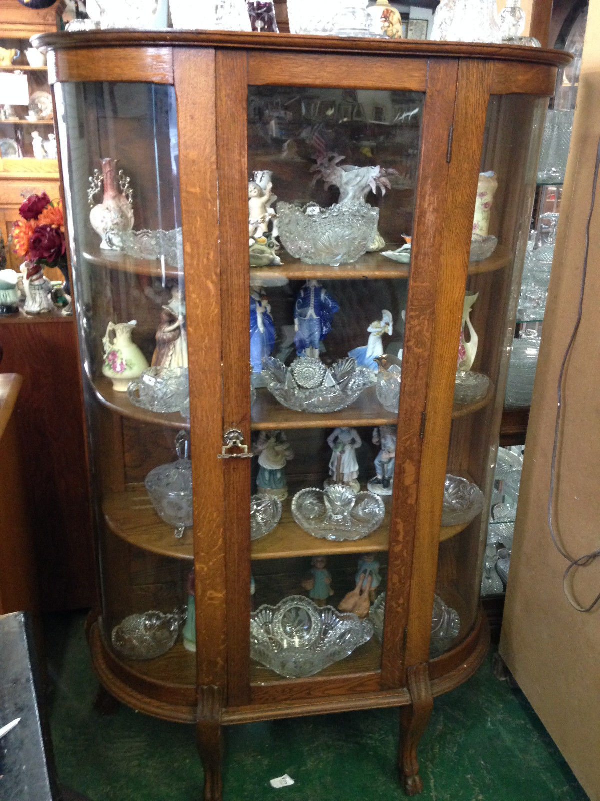 Antique oak round glass front curio cabinet wood shelves