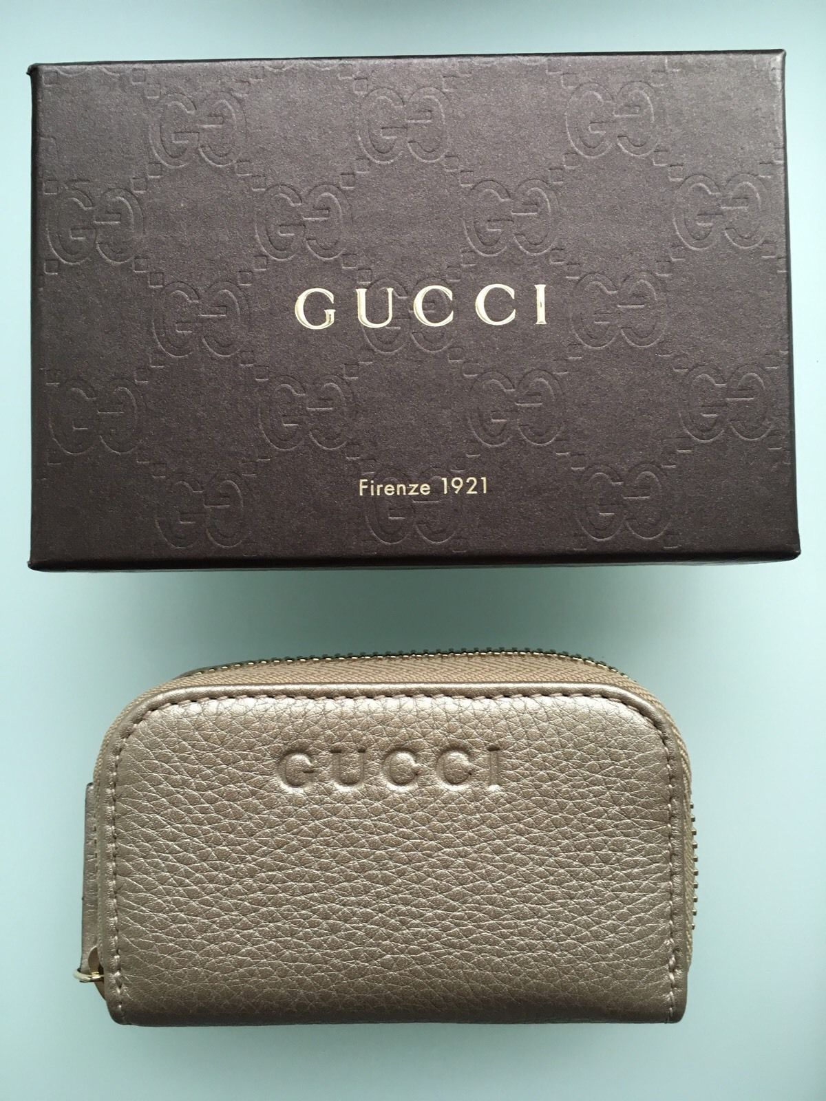 7462a056d24 GUCCI Small Zip Around Gold Metallic Wallet and 50 similar items