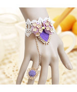 Purple Flower Ring and Golden Mini Flower Ribbon Bracelet - $7.00