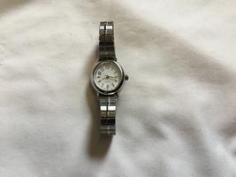 Vintage Women's Wristwatch Quartz Japan Movement Silver Tone & White Face - $6.00