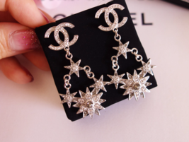 AUTHENTIC CHANEL 2015 CC LOGO STAR CRYSTAL DANGLE EARRINGS SILVER RARE image 6