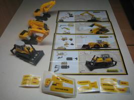 Kinder - 2010 NV96 - NV99 Vehicles - New Holland - complete set + 4 papers - $13.00