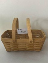 """1999 Longaberger Basket 10""""x6 1/2""""x 7"""" to the top of the handle with plastic lin - $12.00"""