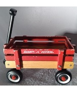 RADIO FLYER  MINI  RED  WAGON  WITH  MOVEABLE  WHEELS - $11.00
