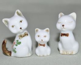 Three miniature cats ceramic painted with flowers - $7.00