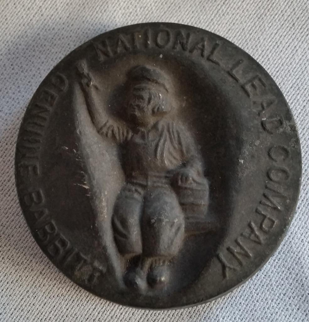 "National Lead Company 3 1/2"" Round Paperweight Babbit Dutch Boy Symbol Ingot"