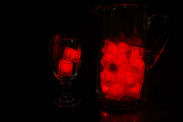 Set of 24 Litecubes Jewel Color Tinted Ruby Red Light up LED Ice Cubes - $52.03 CAD