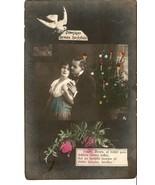 Postcard tinted photo latvia psr merry christmas happy new year man woma... - $14.53