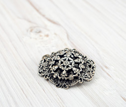 Silver plated brooch - $18.18