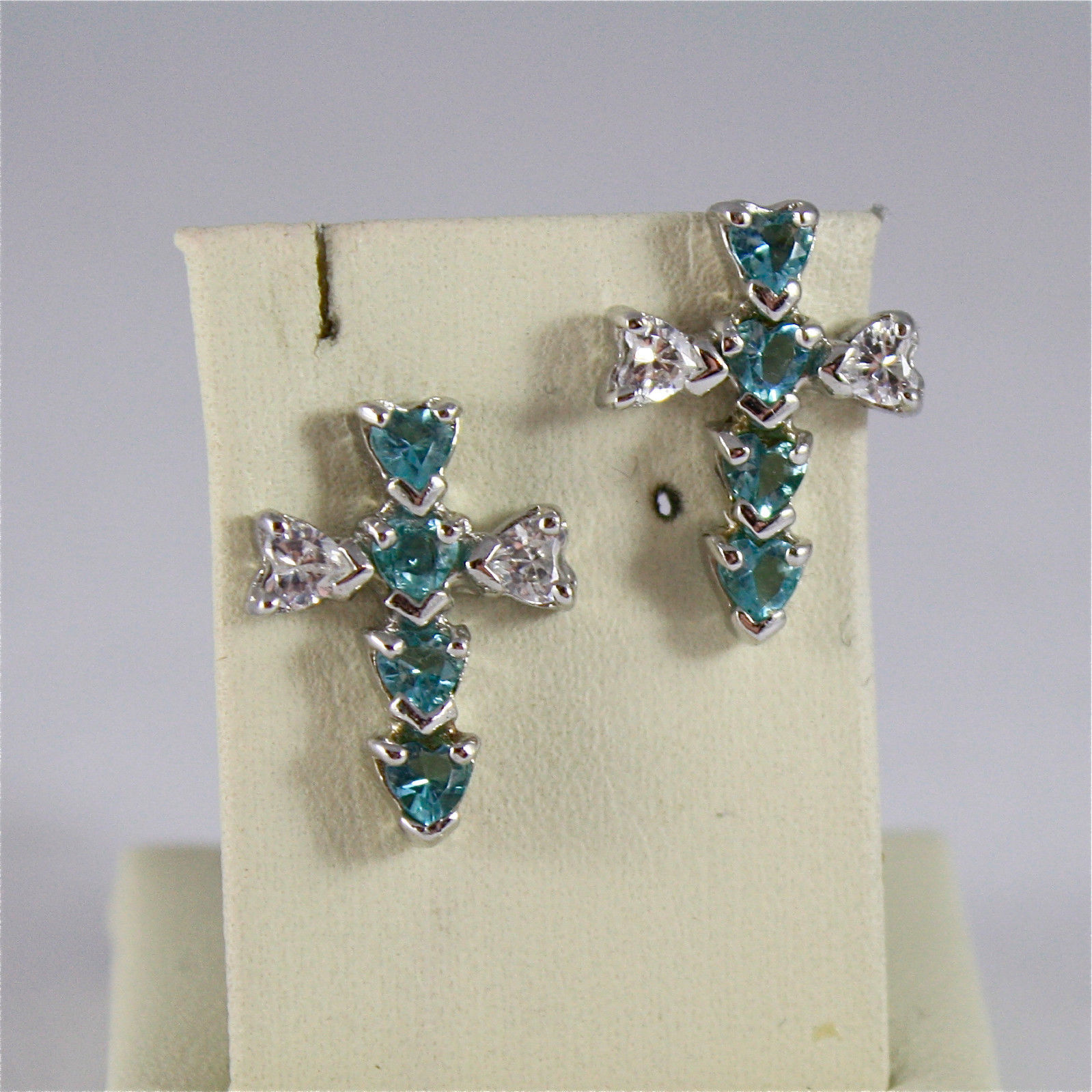 .925 RHODIUM SILVER EARRINGS, STYLIZED CROSS, FACETED ZIRCONIA, WHITE AND BLUE.