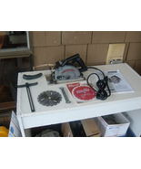 PORTER CABLE 120V 9A 345 TYPE 3 SAW BOSS WITH RIP FENCE AND NEW BLADES. ... - $205.20