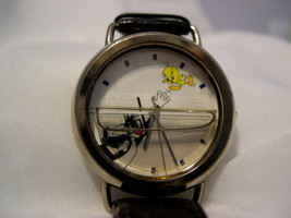 "C04, Fossil, Sylvestor and Tweety, Watch has Water Feature, 8.5"" Calfskin Band - $19.79"