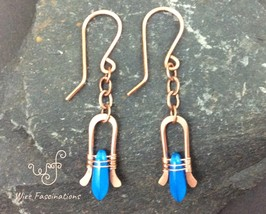 Handmade copper earrings: chain dangling wire wrapped blue glass dagger ... - $25.00