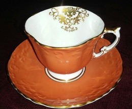 Aynsley Orange Teacup and Saucer Embossed Gold Guild Scalloped Edge - $22.43