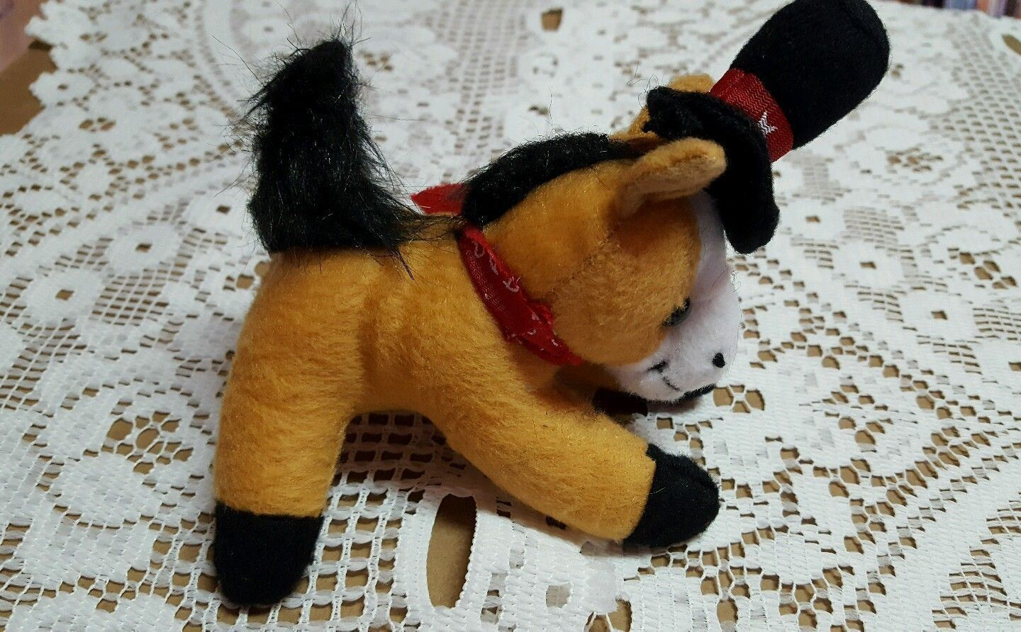 Four and a half inch stuffed horse black and red hat with stars red scarf