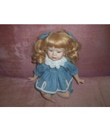 PORCELAIN DOLL IN DENIM DRESS W/ LACE 2 HAIR BOWS IN HER HAIR - $24.50