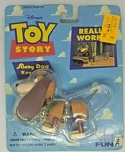 Vintage Sealed 1995 Toy Story Slinky Dog Keychain NIB Toys R Us Label - $16.99