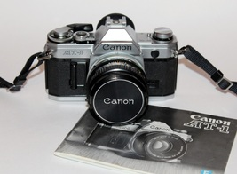 CANON AT-1 CAMERA WITH 50mm f/1.8 FD LENS & INSTRUCTION MANUAL - $120.00