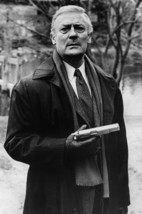 Edward Woodward in The Equalizer as Robert McCall in Black Raincoat Holding Gun  - $23.99