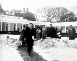 President John F. Kennedy walks through snow on White House lawn Photo P... - $7.05
