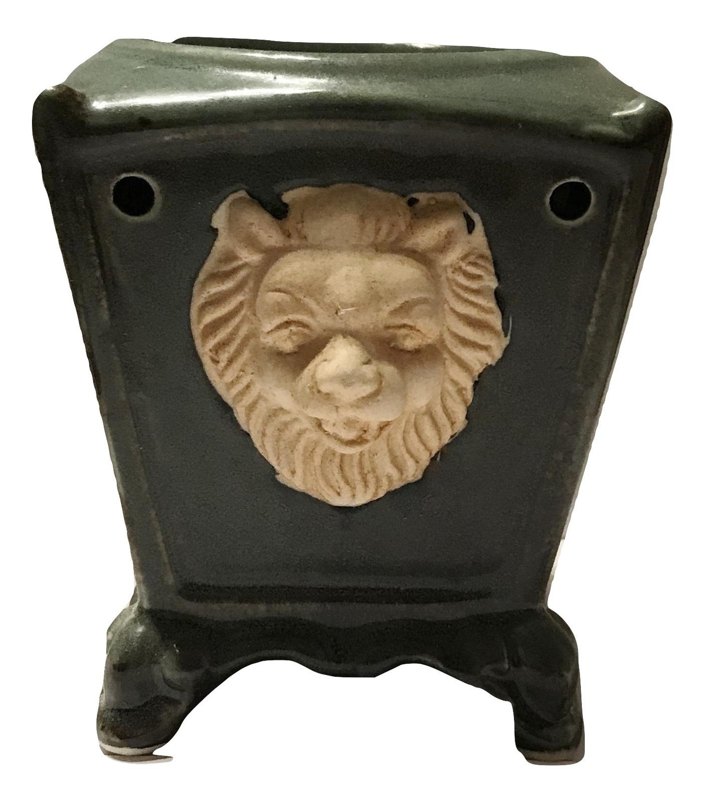 Green ceramic lion oil burner 2 burned
