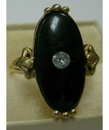 Avon ring with black stone has clear rhinestone in center size 5 1/2 - $9.90