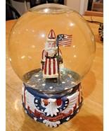 Santa WITH USA FLAGS SNOW GLOBE MUSICAL -PLAYS America  - $29.69