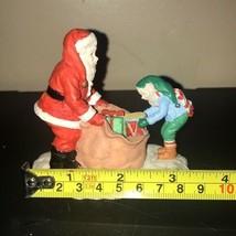 Christmas Santa Claus and Elf in Toy Sack Figurine Hallmark Store 1997 Vintage - $17.35
