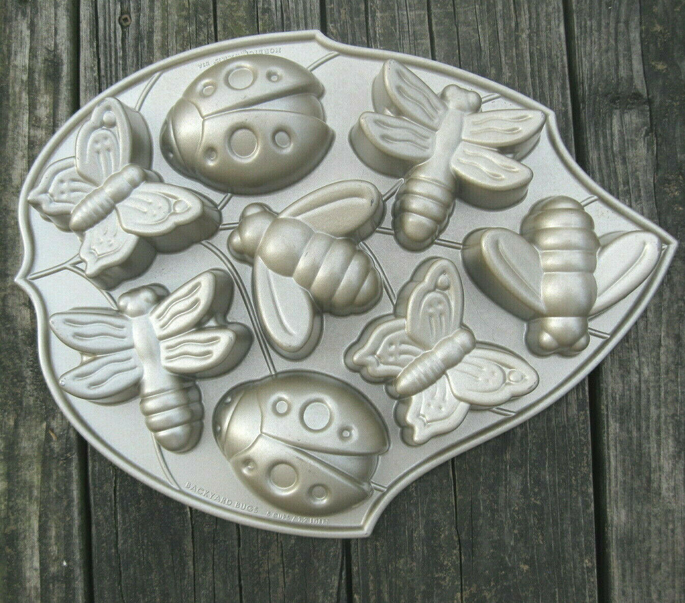 Primary image for Nordic Ware Cake Mold Insects Butterfly Ladybug Backyard Bugs Muffin Pan USA