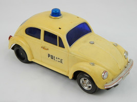 Vintage Battery Operated VW Beetle Police Car Electronic Bump N Go Toy C... - $39.63
